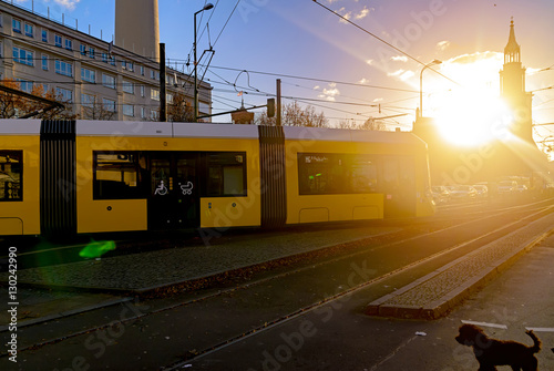 Modern electric tram yellow color on the streets of Berlin Canvas Print
