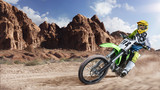Professional dirt bike rider racing on the desert