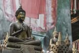 Row of Buddha statues at Ganagarama temple, Colombo, Sri Lanka