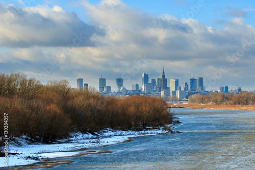 Warsaw sky line with skyscrapers of city center, Vistula river shore in winter