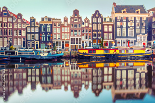 Amsterdam canal Singel with typical dutch houses and houseboats during morning blue hour, Holland, Netherlands Poster