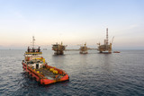 A tug boat performing anchor handling task at oil field