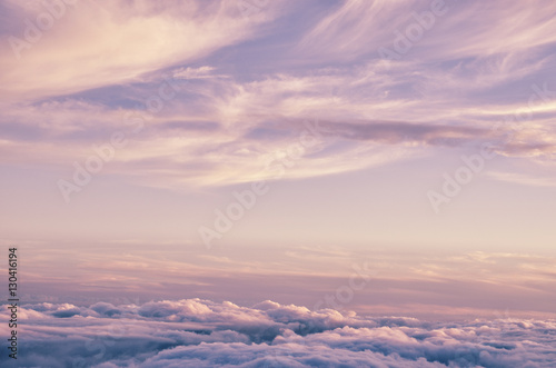 Foto Murales Abstract background with pink, purple and blue colors clouds. Sunset sky above the clouds. Dreamy fantasy background in soft pastel colors.