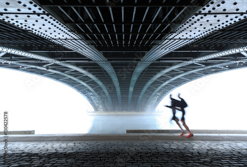 Poster Anonymous male athletes running under a bridge in Lyon on a foggy winter day