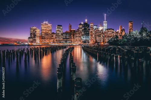 Poster Lower Manhattan skyline night view from Brooklyn Bridge Park in New York City