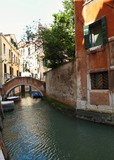 VENICE, ITALY - MAY 27, 2015 : street view of a boat on Venice's canal in the old city center of Venice.