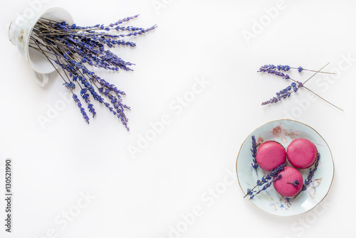 Foto op Canvas Macarons Creative composition with cup, macarons cookies and lavender flowers on white background