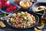 Salad of sprouted chickpeas with couscous, avocado, parsley, olive oil and pomegranate - 130526575