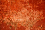 Design space. Abstract bright red background. Wall concrete damaged by time. Flat background with scratches and cracks