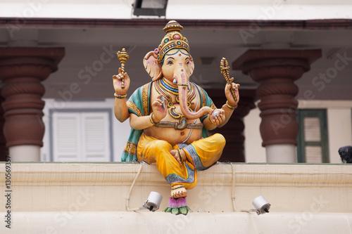 Obraz na plátne Statue of Ganesha on top of a building