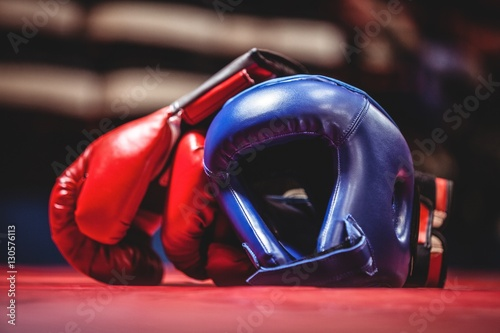 Boxing gloves and headgear in boxing ring