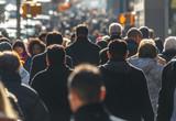 Crowd of people walking on a street - 130586359