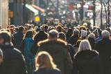 Crowd of people walking on a street - 130586370