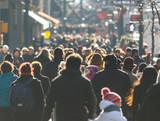 Crowd of people walking on a street - 130586374