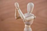 Wooden figurine applauding