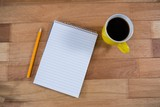 Coffee mug with notepad and pencil
