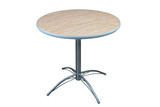 Table with round laminate top and stainless steel base.