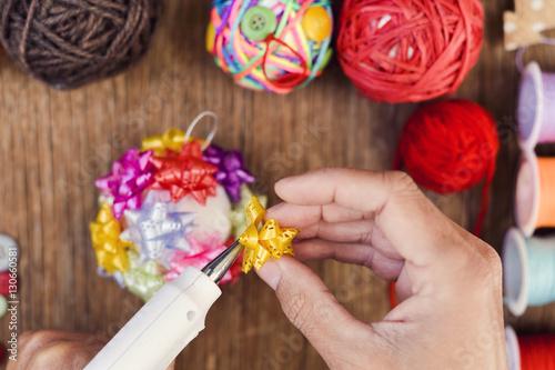 man making a handmade christmas ball Poster