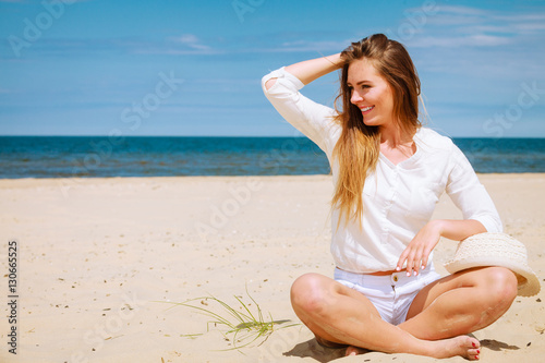 Female tourist resting on beach. Plakat