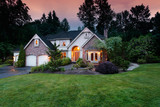 Home lights shine at twilight - 130673349