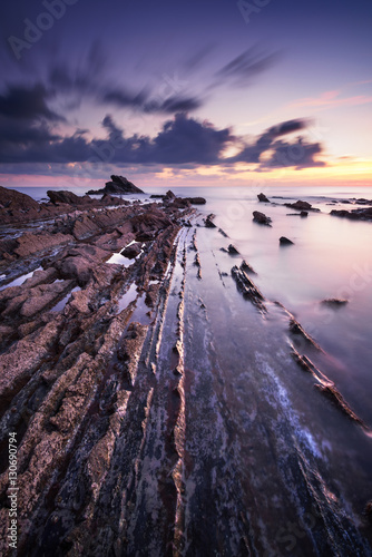 Rocks in a sea on sunset. Tuscany coast. Italy