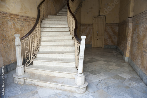 Grand staircase with eye-catching curving bannisters leads up from the ground fl