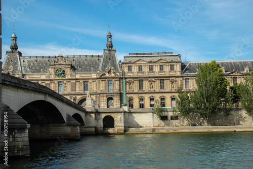 Royal bridge across the Seine river and Louvre museum Poster
