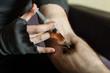 Addict hands making syringe injection of heroin.