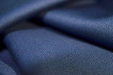 close up texture navy blue fabric of suit