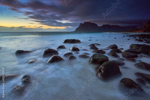 Poster sunset over uttakleiv beach during autumn with the stunning color and beautiful