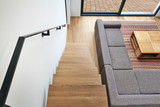 Hardwood stairs and ramp in modern living room - 130879188