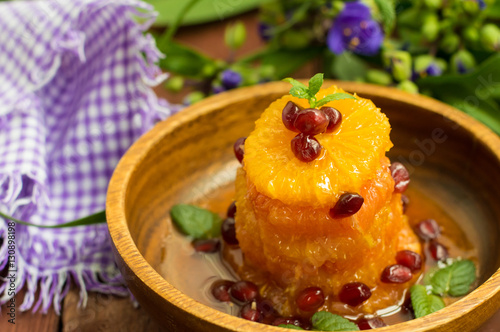 Poster Dessert of fruits watered honey with mint leaves