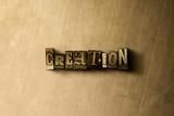 CREATION - close-up of grungy vintage typeset word on metal backdrop. Royalty free stock - 3D rendered stock image.  Can be used for online banner ads and direct mail.