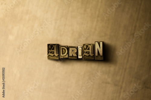 Poster ADRIAN - close-up of grungy vintage typeset word on metal backdrop