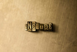 INCLUDE - close-up of grungy vintage typeset word on metal backdrop. Royalty free stock - 3D rendered stock image.  Can be used for online banner ads and direct mail.