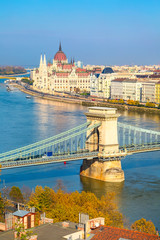 Skyline panorama of Budapest, Hungary with Danube, chain bridge, Hungarian Parliament and houses street view
