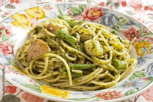 Spaghetti al pesto served in the traditional way Poster