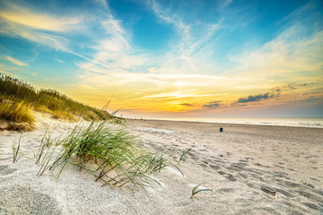 Sand dunes against the sunset light on the beach in northern Poland