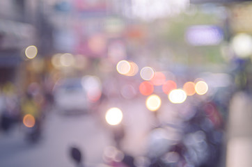 Blur traffic road with colorful bokeh light abstract background.