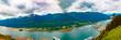 Juneau, Alaska, USA - May 25, 2106:  Panorama of the Gastineau Channel, Juneau cruise ship docks, Mt. Roberts Tramway, Douglas, and the surrounding Tongass National Forest.