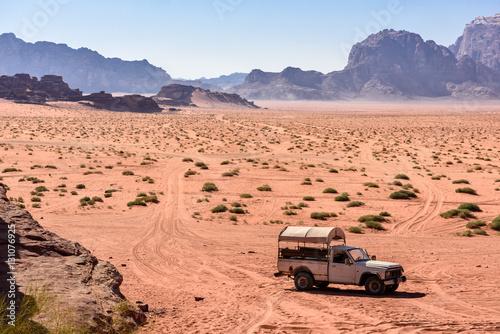 Pick up on a desert path, in wadi Rum, Jordan Poster