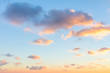 Gentle colors of sunrise sky with  light clouds - background