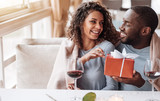 Caring African American man giving the present to his girlfriend