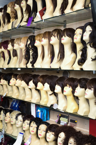 Poster Mannequins with colorful wigs types on shelves