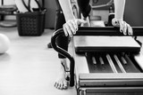 Pilates reformer exercises detail in black and white.