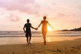 Romantic carefree couple running to the sun at sunset sea beach. Vacation of dream, travel to Thailand - 131109160