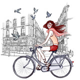 woman riding a bicycle in Paris - 131123161