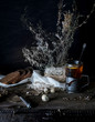 still life. vintage. a simple country breakfast on  wooden table. black background