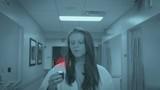 Nurse Looking at HUD in Hospital