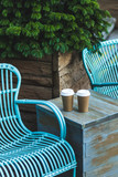 Two cup coffee to go on blue vintage table in beautiful cafe out